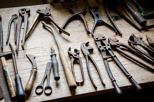 learn how to make a website - tools for making shoes against tools for making websites
